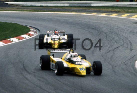 Rene Arnoux (FRA) Renault RE20 Equipe Renault Elf leads Jean Pierre Jabouille (FRA) same car