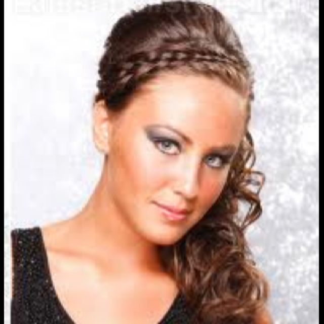 Braid into curly side ponytail with volume on top :)) what I want 4 homecoming!!!