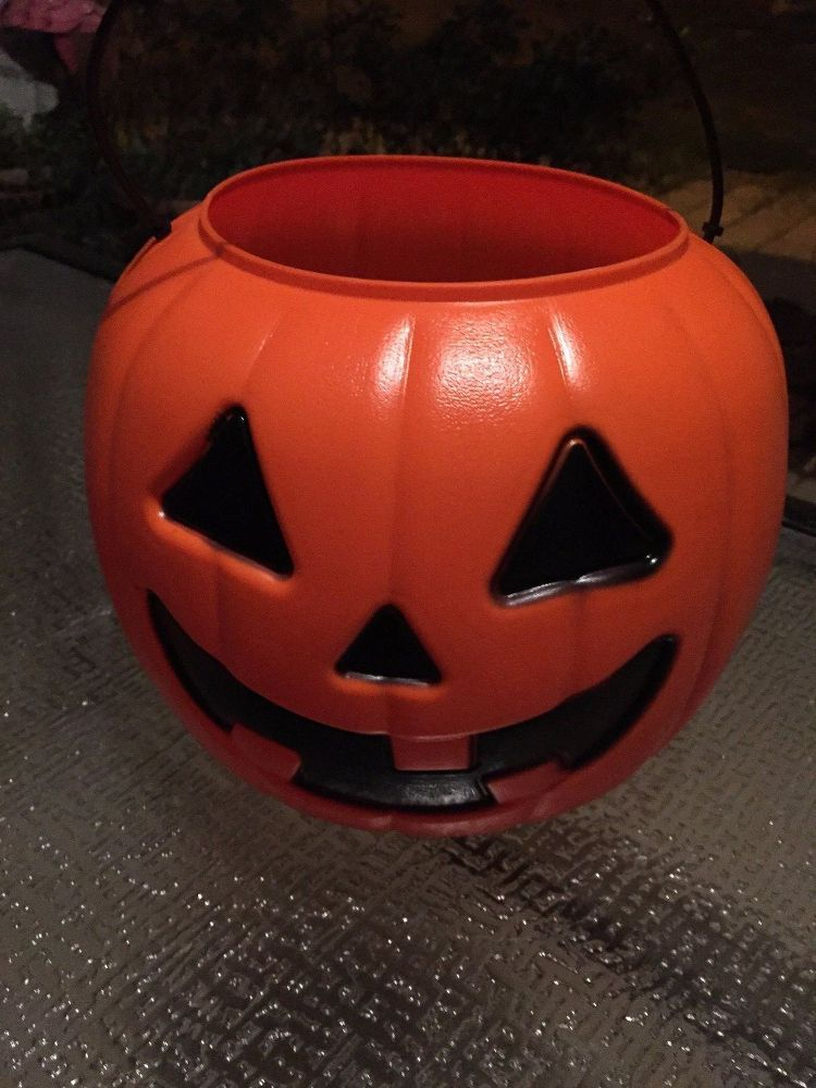 She buys a $1 pumpkin at Walmart, but instead of filling it with - halloween decorations at walmart