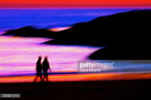 Wales, Anglesey, Trearddur Bay, sunset colours, couple walking... #trearddur: Wales, Anglesey, Trearddur Bay, sunset colours,… #trearddur