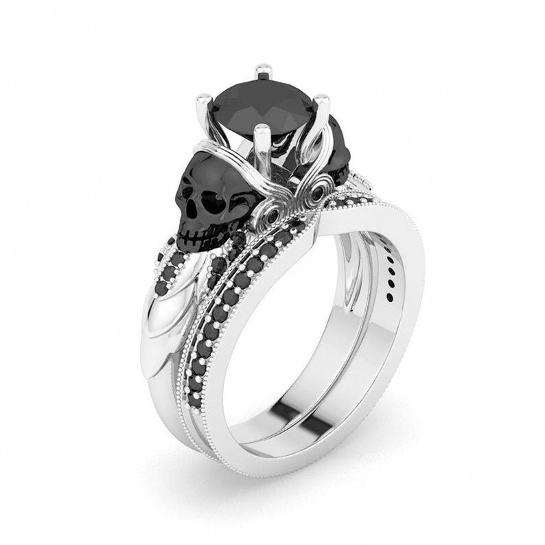"""""""Silver Skull Ring, Gothic Skull Engagement Ring Set, Black Diamond ring, Skull Ring, Skull Engagement Ring, Skull Wedding Ring, Gift For Her THIS RING IS READY TO MADE A ORDER Features ✔ Metal Purity : 925 Sterling Silver ✔ Main Stone Shape : Round ✔ Main Stone : Black Diamond ✔ Main Stone Color : Black ✔ Main Stone Creation : Simulated ✔ Total Carat Weight : 2.00 Ct ✔ Ready to Ship in 3-7 Business Days ✔ Available Metal Finish : Rose Gold Finish / Yellow Gold Finish / Silver ✔ Available Ring S"""