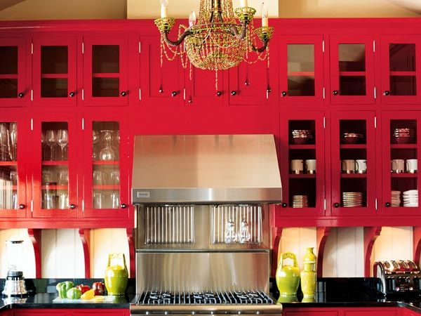 red kitchen Probably would never have the nerve to go for red cabinets but I like this!