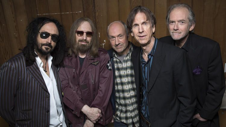 Mudcrutch members are Mike Campbell, left, Tom Petty, Randall Marsh, Tom Leadon and Benmont Tench at Warner Bros. Records in Burbank in April.. (Brian van der Brug / Los Angeles Times)