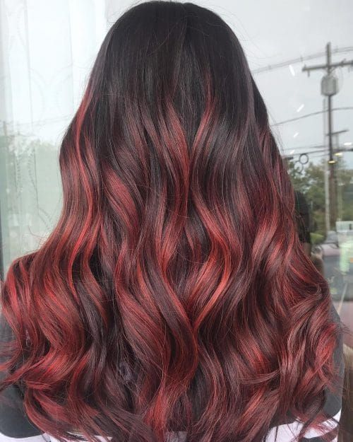 These Sizzling Red Highlights Will Have You Turning Heads Everywhere You Go Get Ready F Red Highlights In Brown Hair Brown Hair With Highlights Black Red Hair