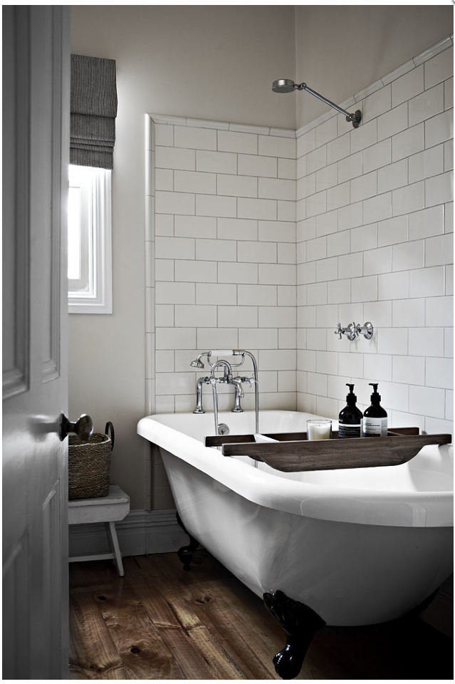 Modern Farmhouse Bathroom Minimalist White Subway Tile Rustic Wood Accents And Silver Finishes