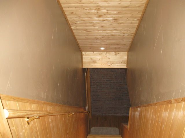 Basement Stair Ceiling Lighting: Stairway To The Basement. Wood Planking On The Lower Wall