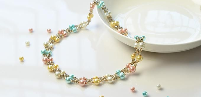 Pandahall video tutorial how to make a simple handmade pearl beaded pearl bead necklace is always chic and delicate do you wanna make handmade beaded necklaces yourself this video tutorial will show you how to make a solutioingenieria Image collections