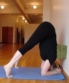 challenge half a headstand with 3 blocks and a wall