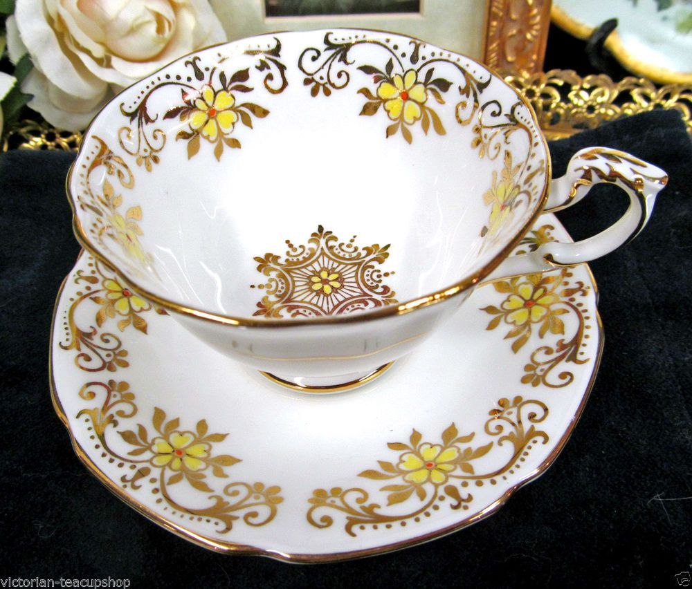 PARAGON TEA CUP AND SAUCER DEMI GOLD GILT YELLOW FLORAL TEACUP