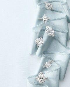 FOR THE ENGAGEMENT || An assortment of diamond rings on tiffany blur raw silk || NOVELA...where the modern romantics play & plan the most stylish weddings...Instagram: @novelabride www.novelabride.com