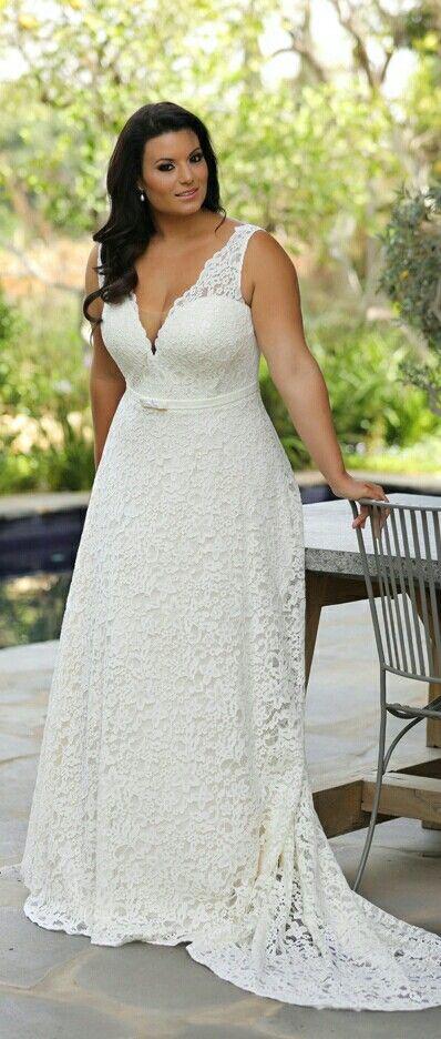 Plus size timeless romantic lace wedding gown. Flatters a curvier ...