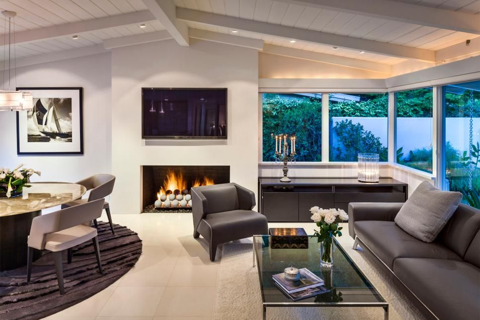 This Sleek Living Room Area Leans On A Gas Fireplace To Give The Space Warm And Welcoming Vibe Matching Gray Leather Sofa Armchair Are Positioned