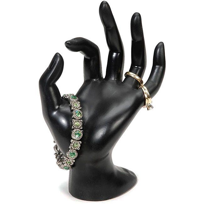 Display your precious pieces in unique fashion with this jewelry display form. The black polyresin form is shaped into a hand so that you can hang your rings or bracelets for easy viewing. This decorative display will add distinction to your decor.