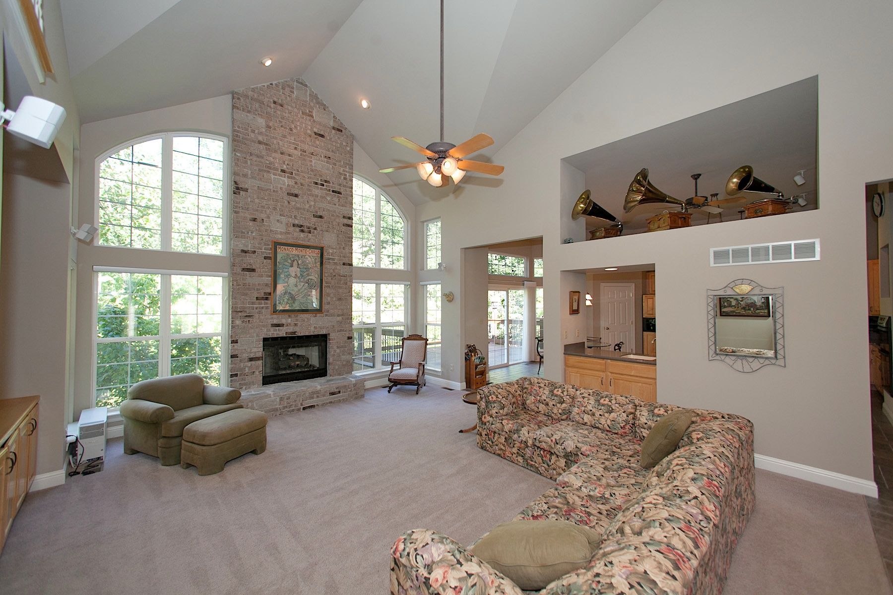 2 Story Great Room With Floor To Ceiling Brick Fireplace And Wet