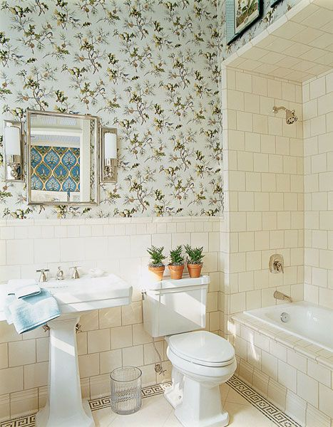 Cute light blue wallpaper and subway tiles in a bathroom. http://cococozy.com