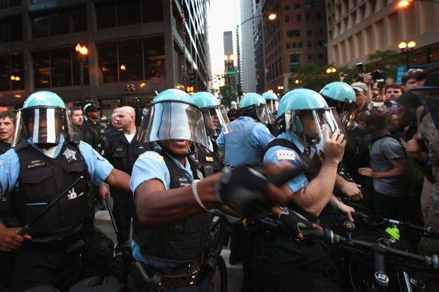 Police hold back demonstrators at NATO Summit