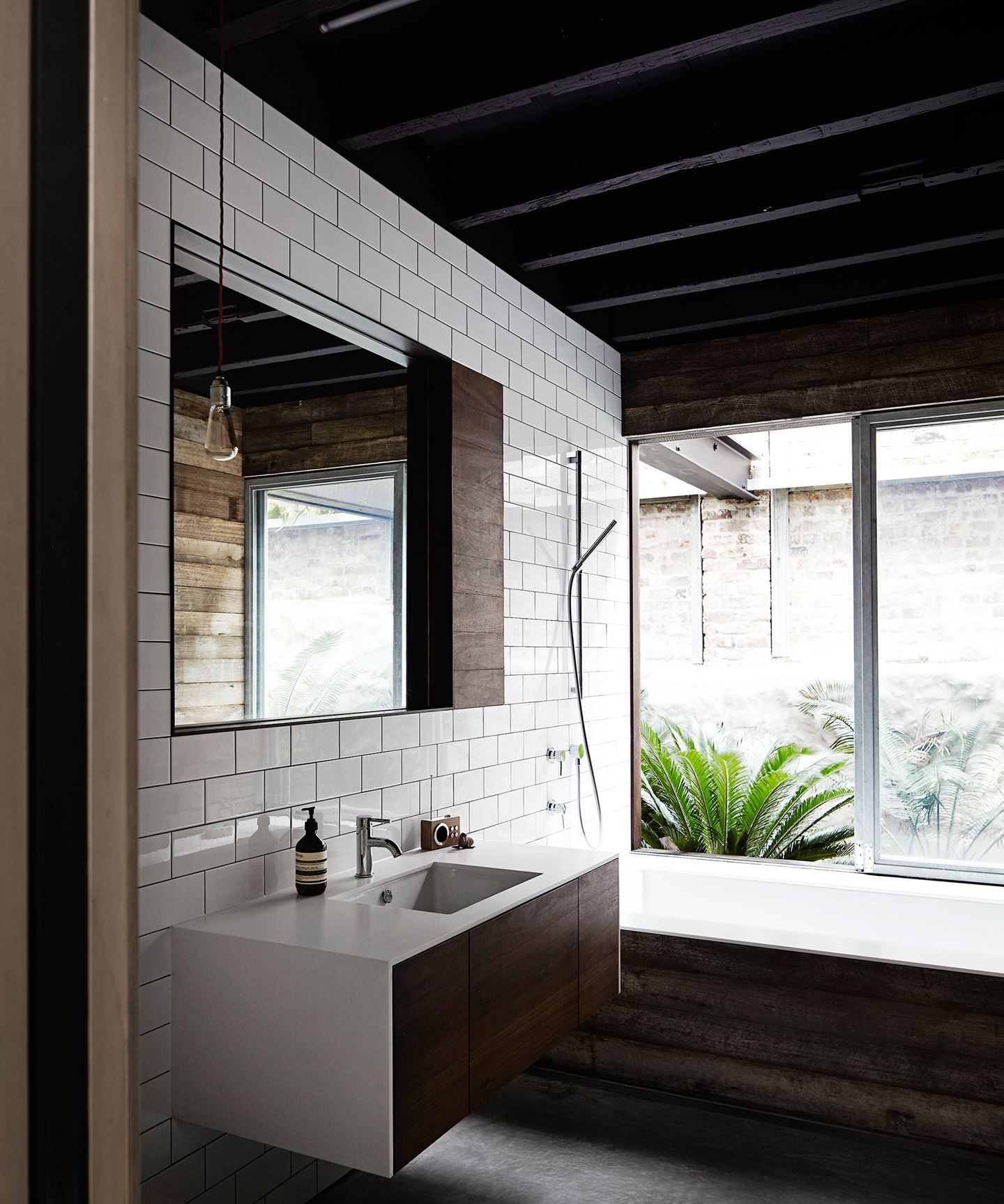 In the bathroom a mix of materials including subway tiles in the bathroom a mix of materials including subway tiles reclaimed wood glass dailygadgetfo Images