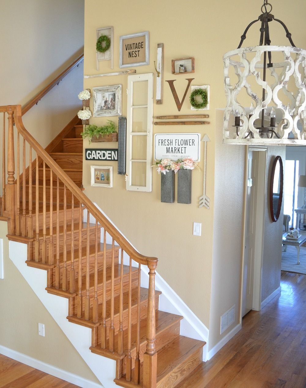 Farmhouse Style Gallery Wall for Spring. Beautiful entryway with vintage inspired gallery wall.