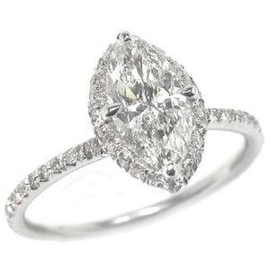 Marquise Cut Diamond Ring Haloed With A 1 2 Carat Of Diamonds Around