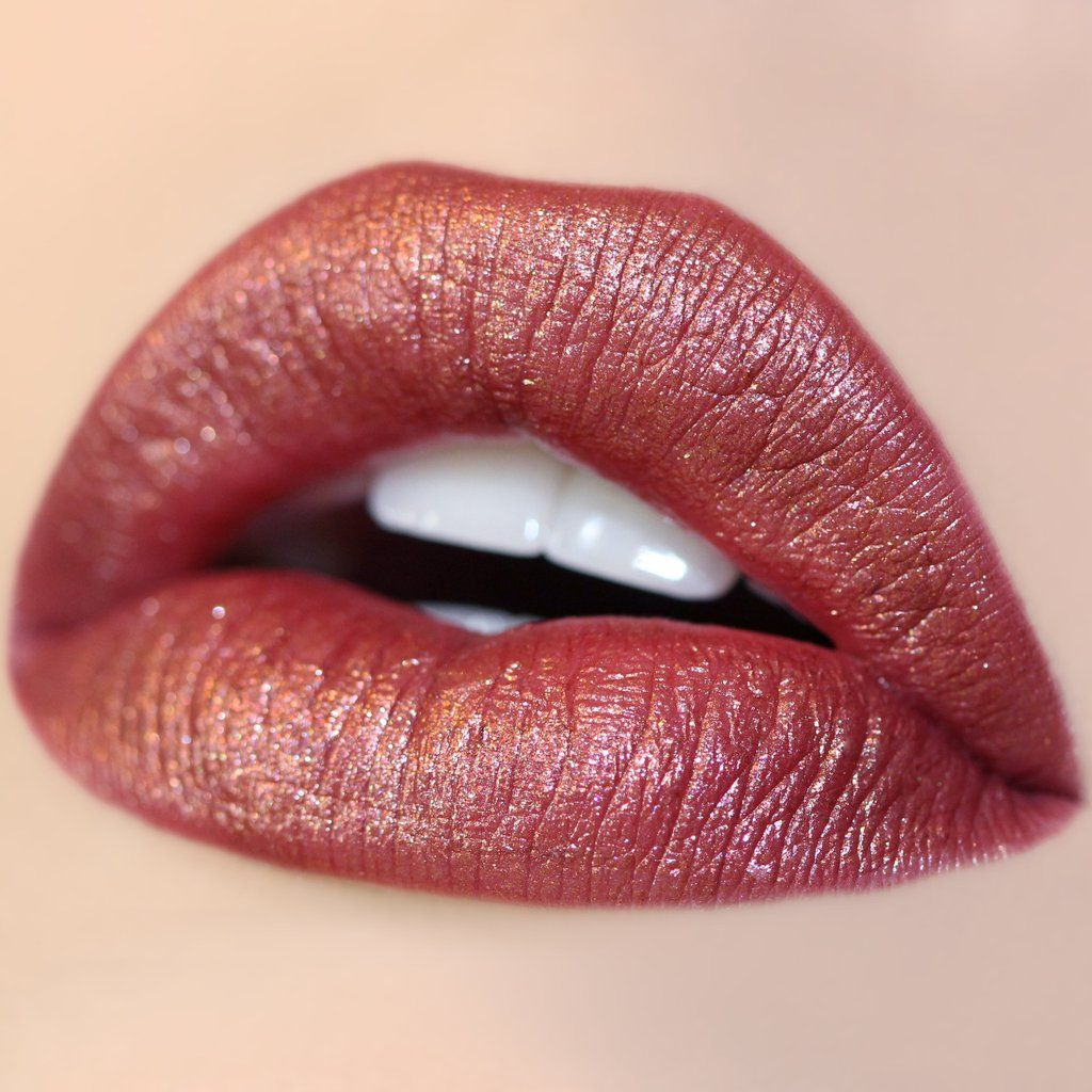 Kween - a burnt red with tons of gold glitter in a Metallic finish😍❤️👄colourpop I love thee😍not even normal how excited I am for this😆the bonus, colourpop is cruelty free and soo affordable! Love them so much💕
