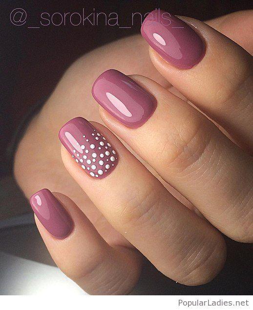 Pink gel nails with polka dots