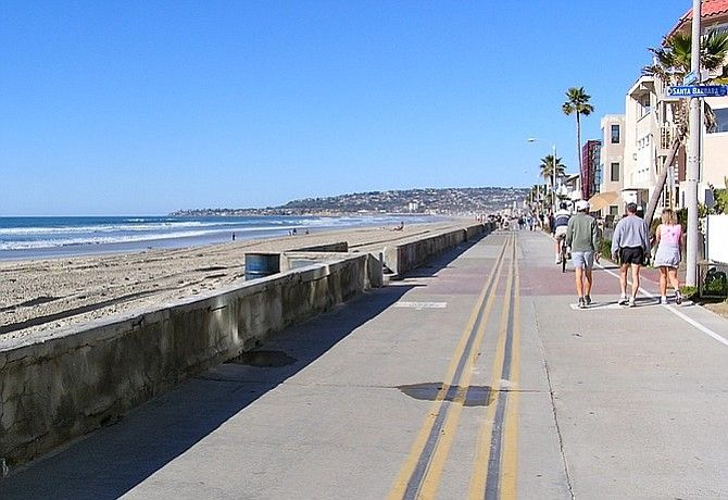 """Off-peak"" hours allow for easier bike riding on the Mission Beach–Pacific Beach boardwalk."