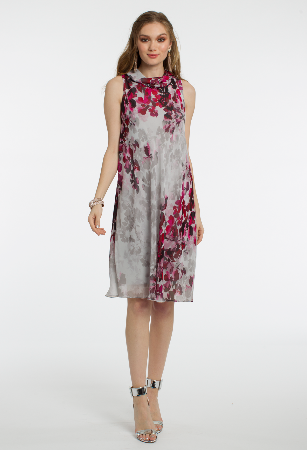 This chiffon flowy kneelength cocktail dress can be