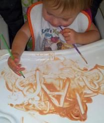 February Curriculum Lesson Plan - #infants #babies teaching letters and shapes using food sauce as a paint