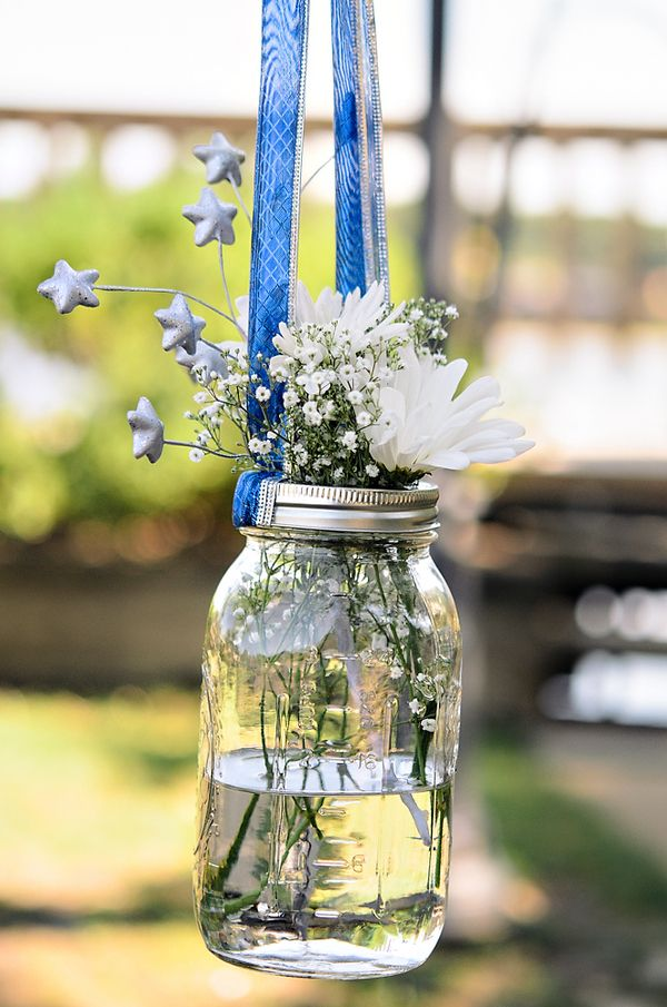 Blue Ribbon Hold Mason Jars Filled With White Baby S Breath Thereddirtbride Com See More Of This We July 4th Wedding Mason Jars