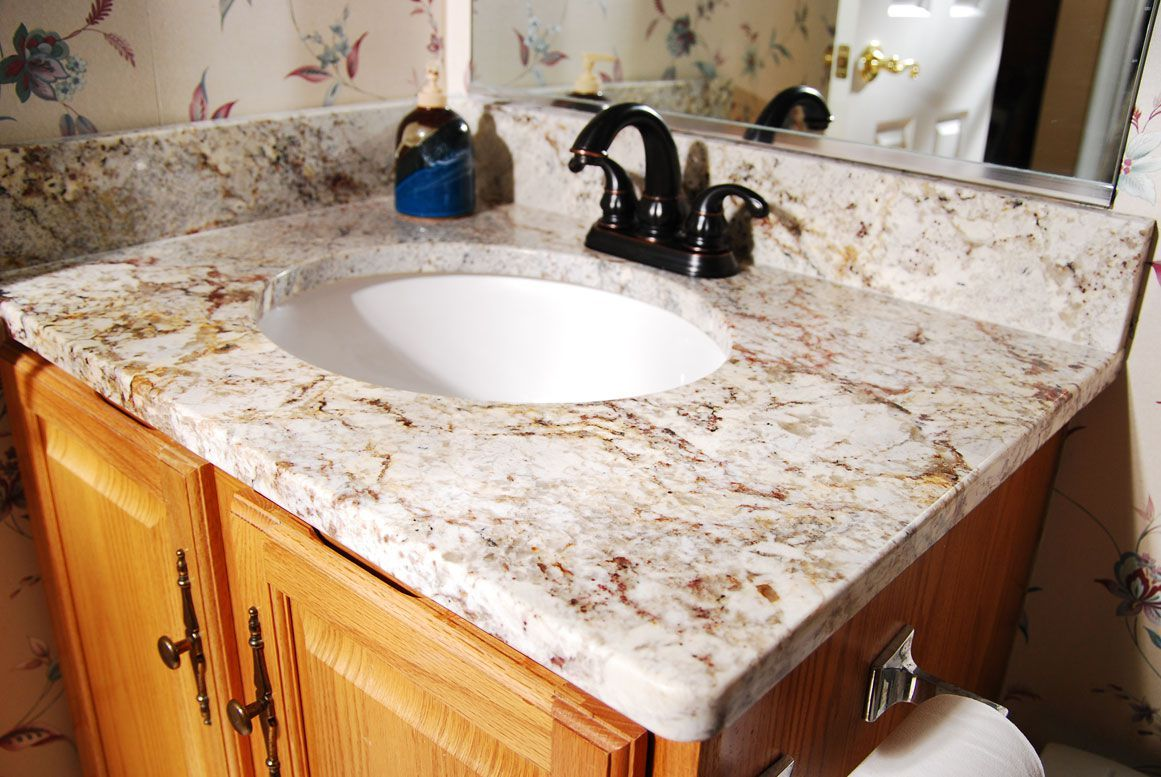 Elegant Bathroom With Vanity Featured Undemount Round Sink And Bronze  Faucet Also Granite Countertops Types Of