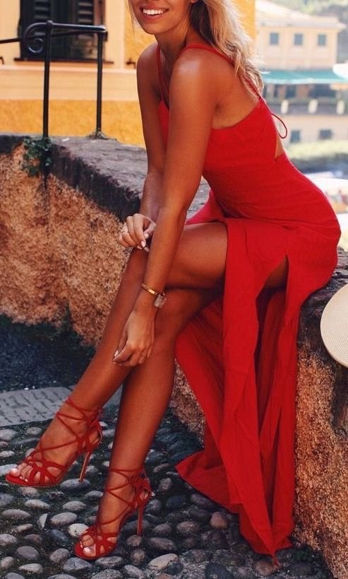 This red double slit maxi dress looks stunning on her. This really makes me want to book my next holiday