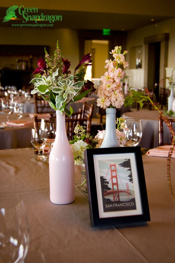High Low Centerpiece Arrangement In Wine Bottle Vases For Wild Pink And Gray Winery Wedding At