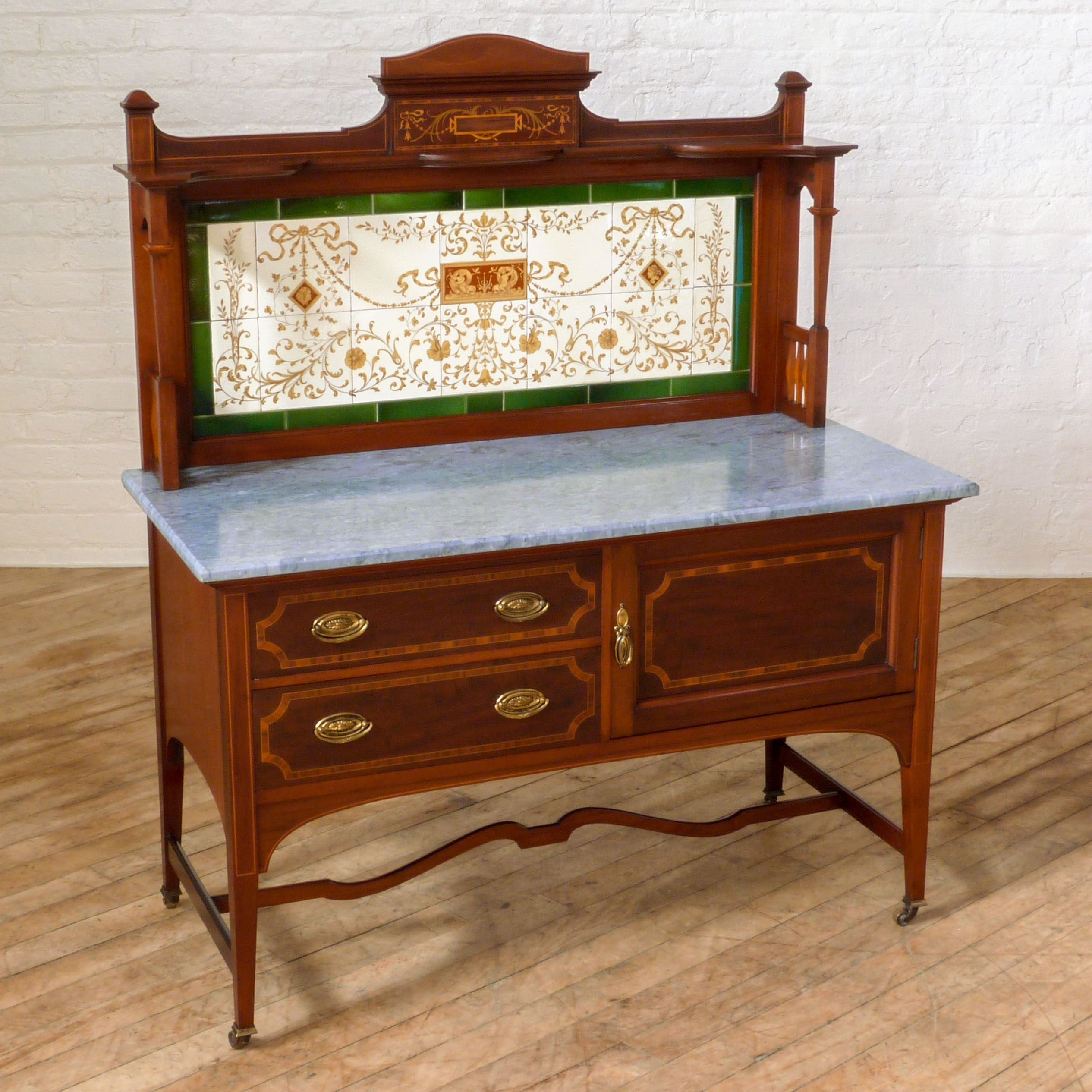 An edwardian mahogany washstand by reputed makers