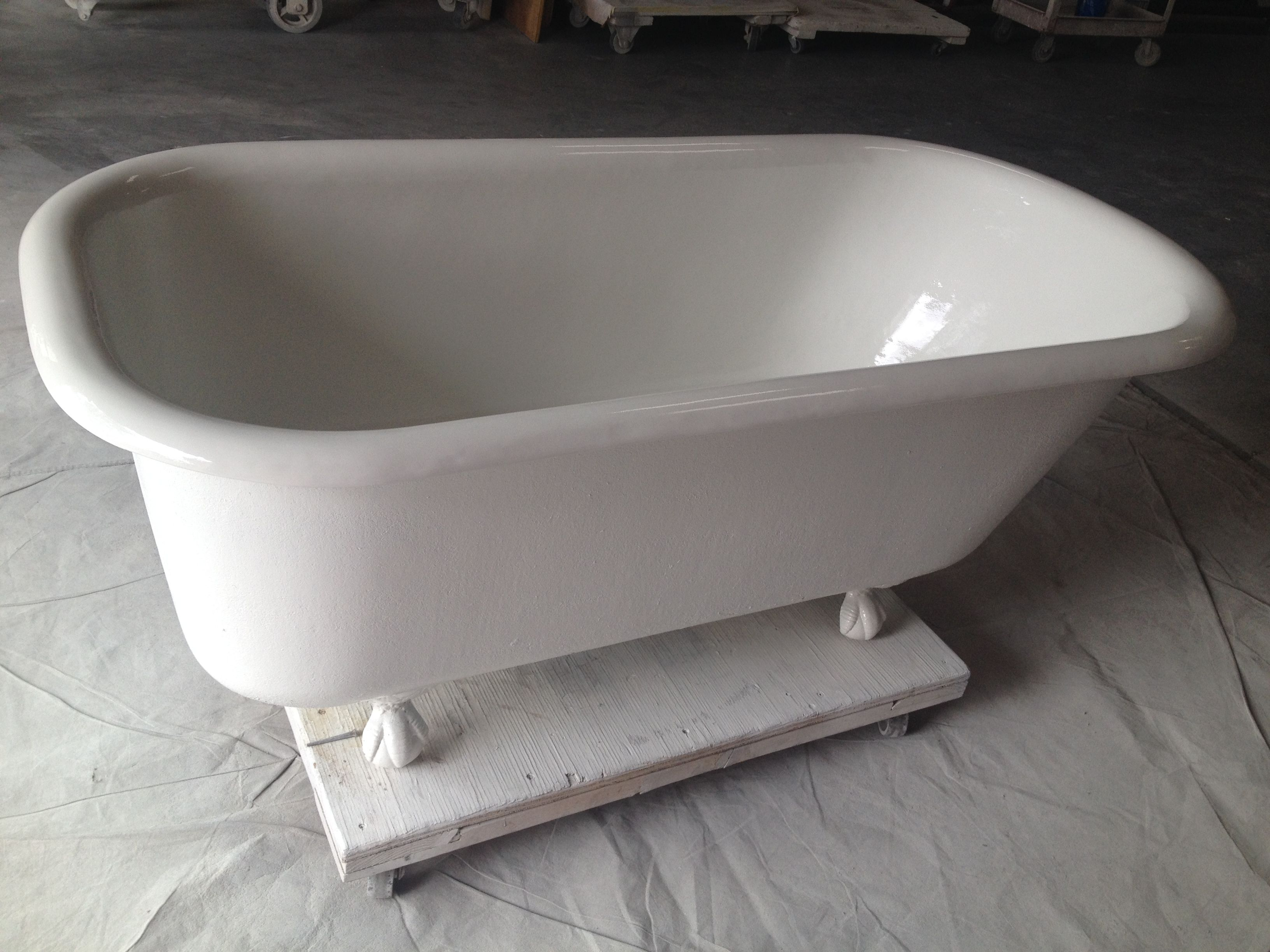 The clawfoot tub looks new after being sandblasted, refinished and buffed!