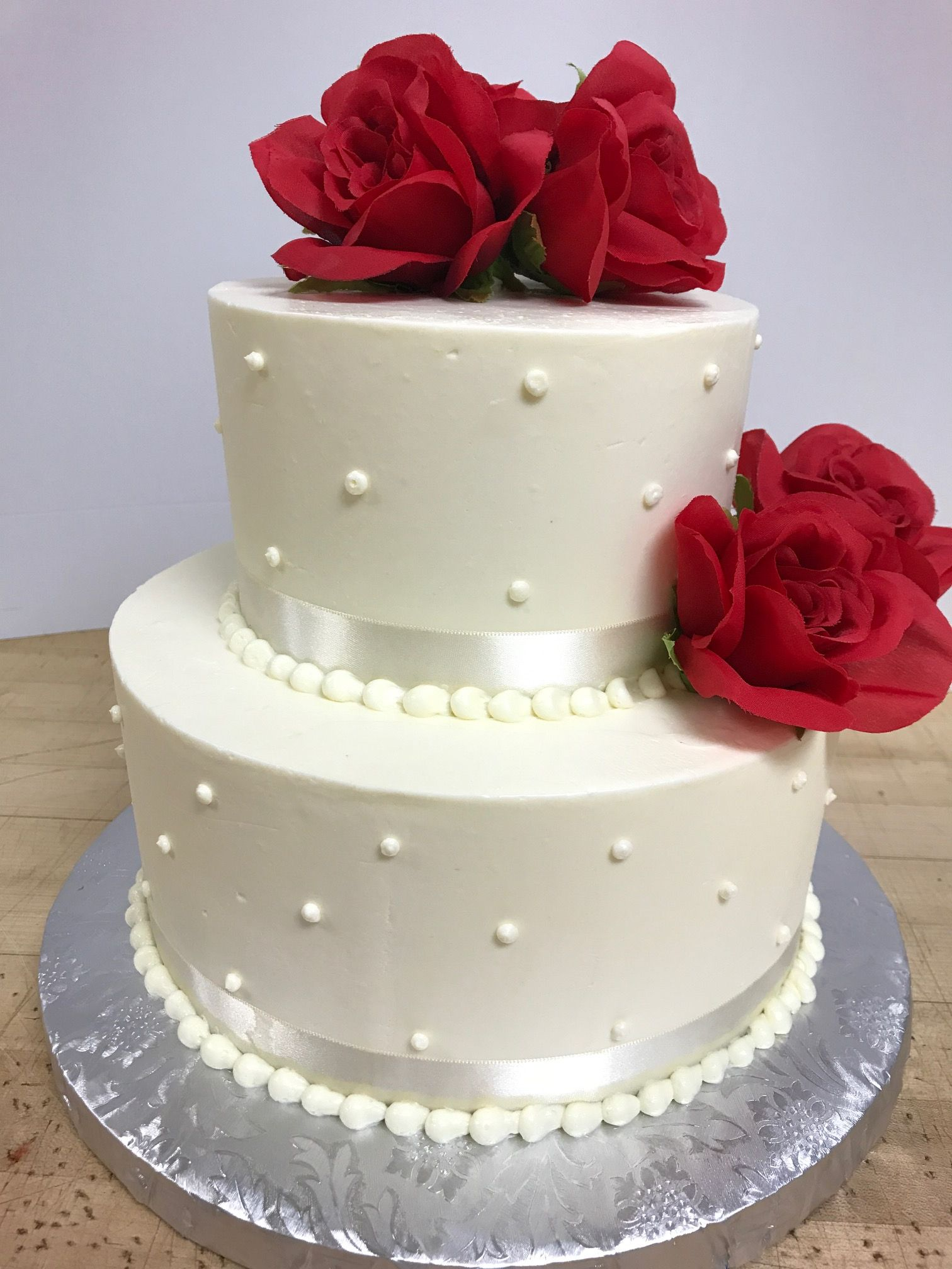 2 Tiered White Cake With Pearl Decoration White Ribbon And Red