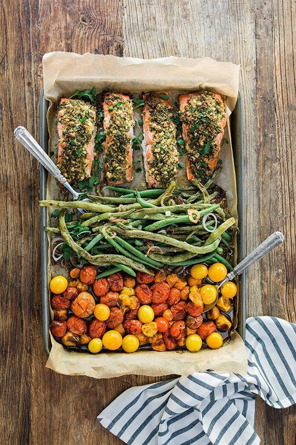 One sheet herb crusted salmon recipe with garlicky green beans & cherry tomatoes. So healthy, and so easy! Waiting On Martha