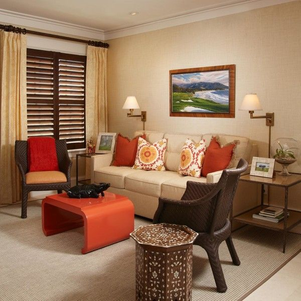 Decoration Creative Orange Living Room Chair Using Stacking Plastic Also Cream Three Seater Sofa Nearby Wrought Iron Side Table Against Wall Sconce