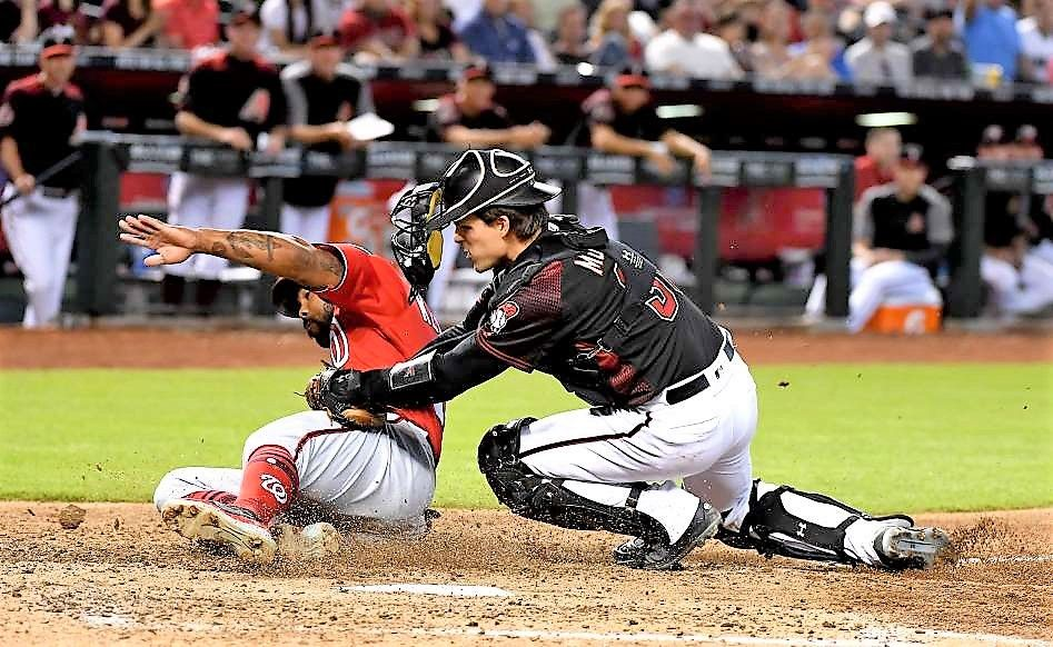 Got Your Back Diamondbacks Catcher John Ryan Murphy Tags Out Howie Kendrick Of The Nationals At Home On May 12 In Phoenix Baseball Boys John Ryan Ryan Murphy