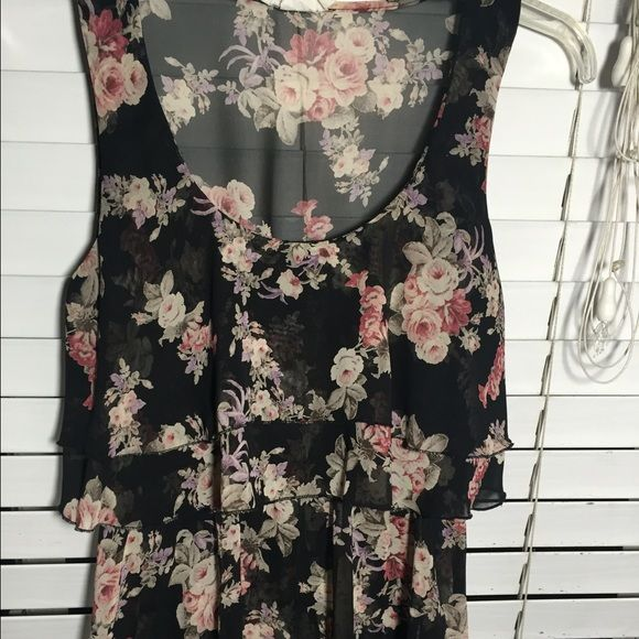 Black sheer floral blouse Floral design sheer top, layered at top. No zipper, top stretches at top Tops Blouses