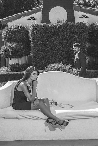 Her: Versace black jersey tank dress, $1,300; Joe Vilaiwan crystal necklace, $880; Barbara Bui silver handbag, $660; Pollini black strappy shoe, $960; Him: Belvest black dinner jacket, $4,195; Ermanno Scervino tuxedo shirt, $510; all available at Presage.