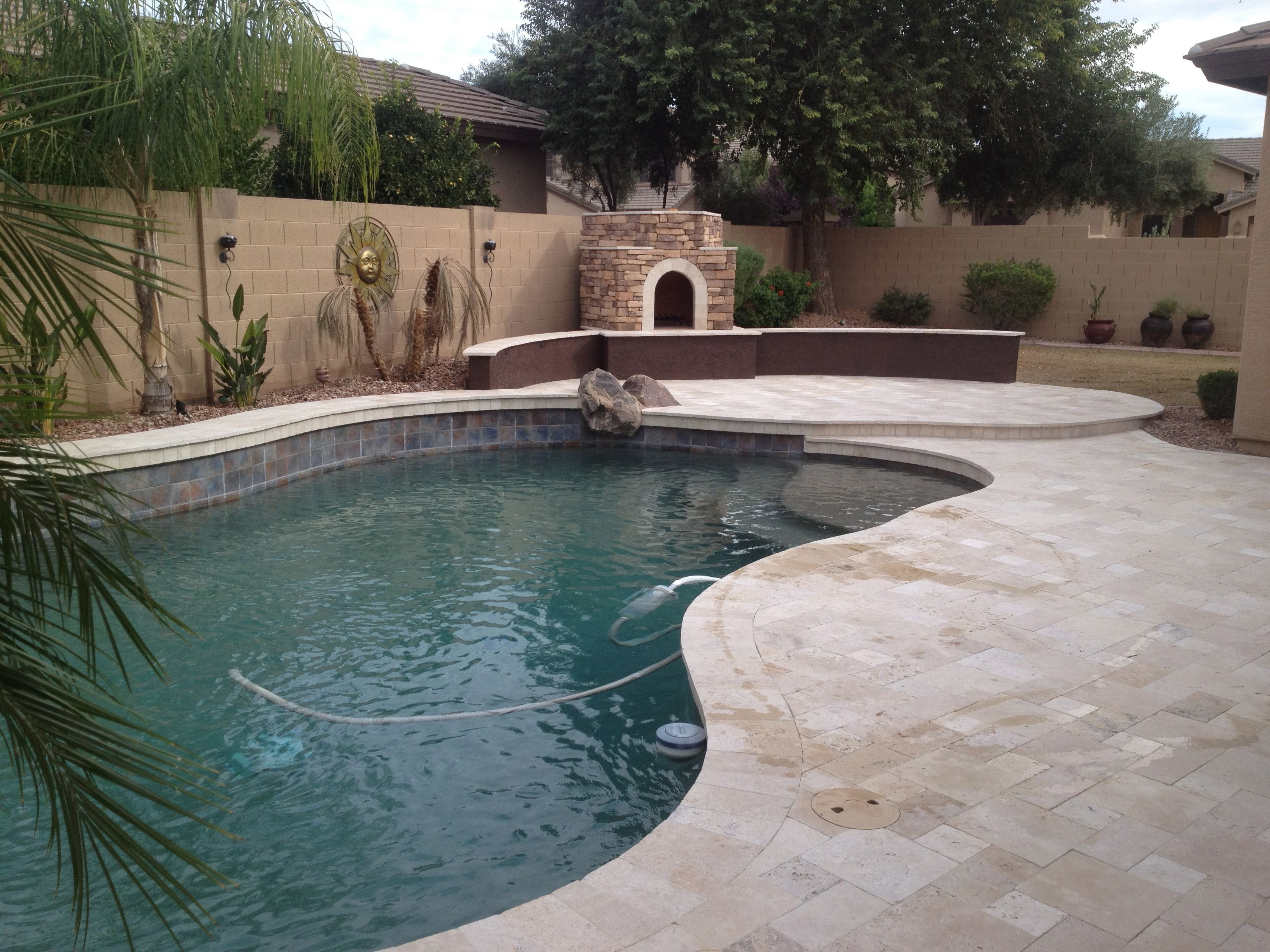pool with travertine decking same color coping