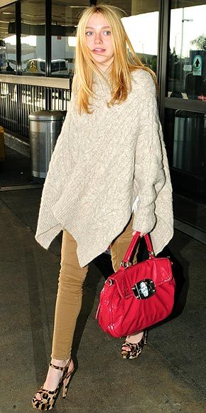 fe8d628087 Dakota Fanning leaving the airport...looking like every teenage girl should.  AllSaints cape