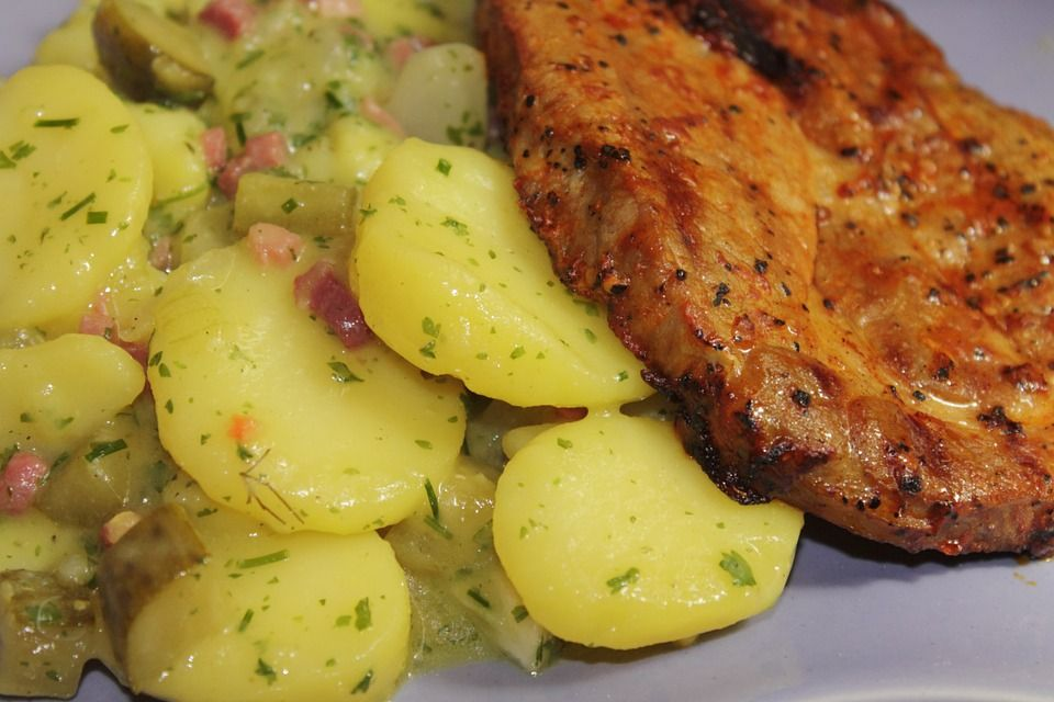 A warm German Potato Salad recipe made with a vinaigrette instead of mayonnaise.