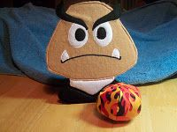 Super Mario Birthday Party Game - knock out the Goomba! DIY  the goomba is made out of felt and the fire power ball is cotton.