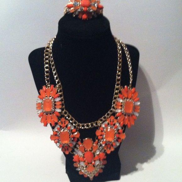 Statement necklace & bracelet orange rhinestones Brand new statement necklace and bracelet Jewelry Bracelets
