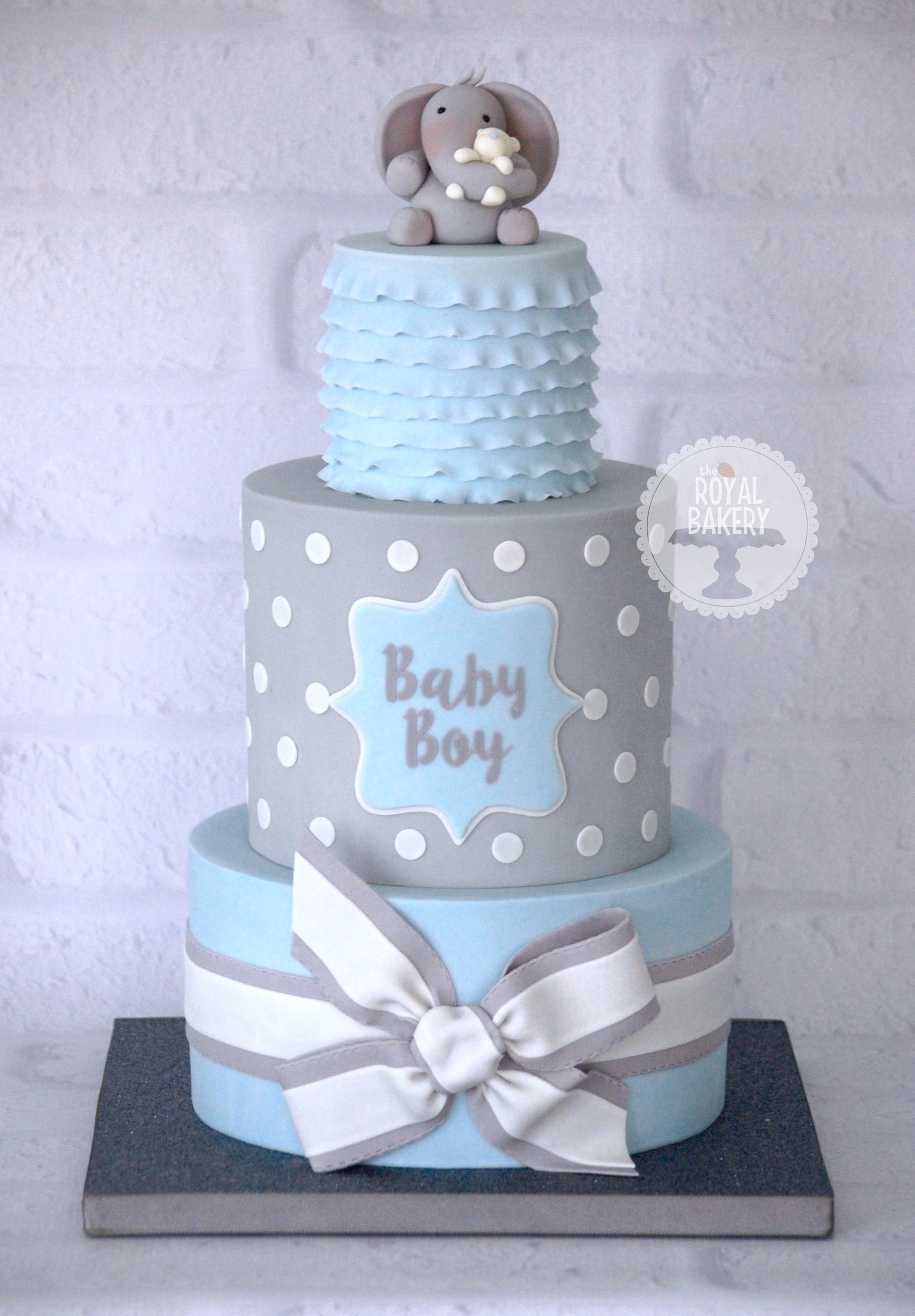 A baby boy blue and grey baby shower cake based on a design