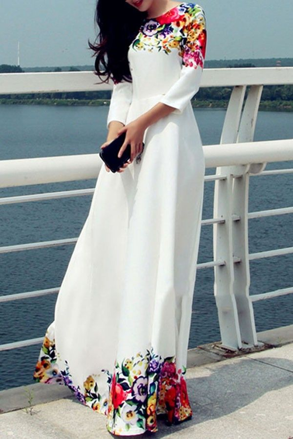 869532132728 ... fanciful floral maxi dress. With round neckline this white number with  multi color floral print detail is totally chic with 3 quarter sleeve  feature.