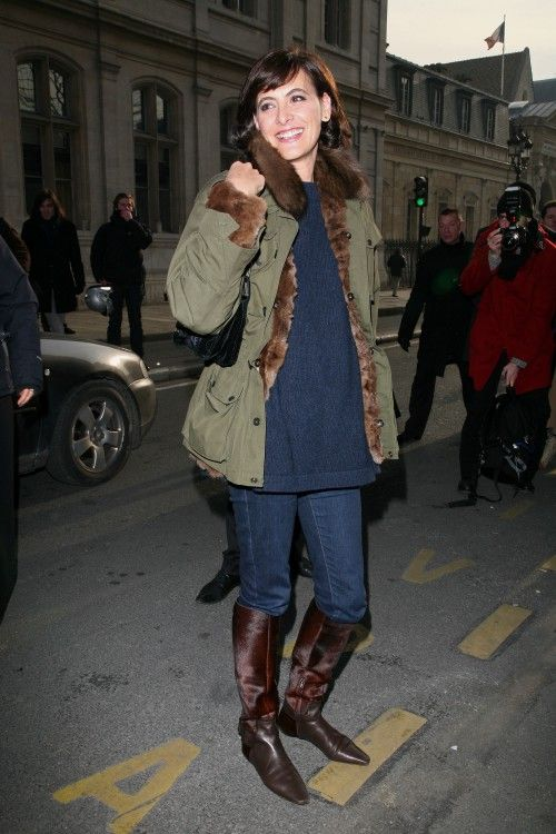 Why we like this Ines de La Fressange look: Ines heads out to a fashion show wearing jeans, a knit tunic and army jacket lined with fur. Even her tall boots have a luxe edge to them with a hair-on-hide shaft.Steal Ines' look: Ines certainly isn't the only fashionista to mix casual with dressy pieces...