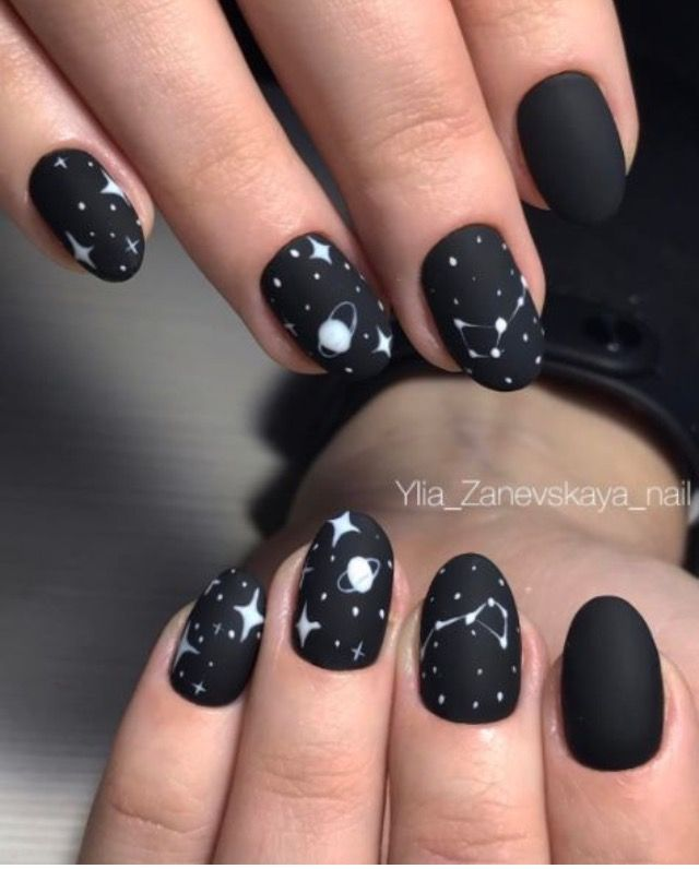 Cosmic black and white nails