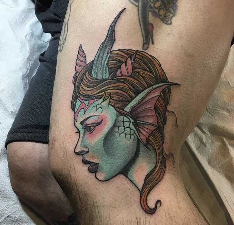 Neotraditional style mermaid tattoo on the left leg by